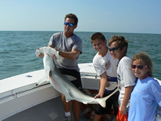 Kids shark fishing with Bald head island fishing charters